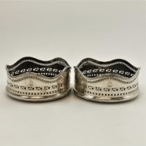 A PAIR OF 18TH CENTURY IRISH SILVER WINE BOTTLE COASTERS, Dublin, 1786, maker mark rubbed but