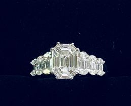 AN 18CT WHITE GOLD BAGUETTE AND MARQUISE DIAMOND RING, with baguette diamond shoulders finished with