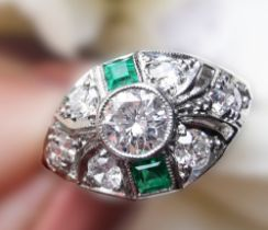 A BEAUTIFUL ART DECO PLATINUM EMERALD AND DIAMOND EYE SHAPED RING, with the finest of gemstones,