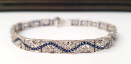 A STUNNING 18CT WHITE GOLD DIAMOND AND SAPPHIRE BRACELET, with round brilliant cut diamonds,
