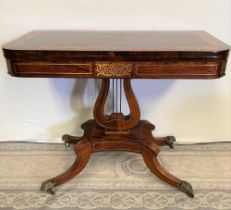 A VERY FINE REGENCY ROSEWOOD BRASS INLAID FOLD OVER CARD / GAMES TABLE, with stunning brass inlaid