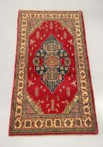 A KAZAK RUG, hand woven in Central Afghanistan in Hazarajat Region, close to the Bamiyan Valley,