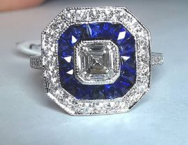 AN INCREDIBLE PLATINUM SAPPHIRE AND DIAMOND TARGET RING, with top quality natural gemstones
