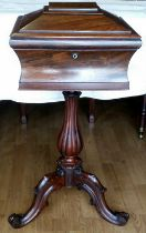 A WILLIAM IV ROSEWOOD SEWING BOX, circa 1830, of sarcophagus shape, the top lifts to reveal fabric