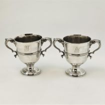 A PAIR OF MID 18TH CENTURY IRISH SILVER TWO HANDLED CUPS, Dublin, 1753, with maker mark of DK within