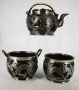 A LATE 19TH / EARLY 20TH CENTURY CHINESE HORCHUNG PEWTER AND BLACK STONEWARE TEA SET, decorated