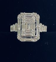 A UNIQUE 18CT WHITE GOLD BAGUETTE AND ROUND BRILLIANT CUT DIAMOND RING, the workmanship in this ring