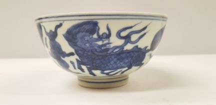 A BLUE & WHITE CHINESE PORCELAIN BOWL, decorated to the body with Chi Lin figures which symbolise