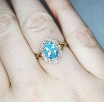 A 9CT YELLOW GOLD VINTAGE BLUE TOPAS AND DIAMOND CLUSTER RING, beautiful colour, ring size M. face