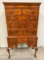 A VERY FINE QUEEN ANNE STYLE WALNUT CHEST ON STAND OR HIGH BOY, with cross-banded detail to the