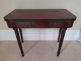 A GOOD 19TH CENTURY FOLD OVER TEA TABLE, with reeded rim, a single frieze drawer, raised on ring