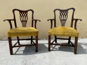 A FINE PAIR OF IRISH MAHOGANY ARM CHAIRS, with shaped crest rail over a pierced splat back, each wit