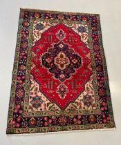A FINE PERSIAN TABRIZ CARPET, hand woven in Eastern Azerbaijan c.1950. Material: woollen pile hand w