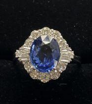 A STUNNING 18CT WHITE GOLD TANZANITE AND DIAMOND ART DECO STYLE RING, claw set, the Tanzanite stone