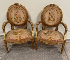 A PAIR OF GILT LOUIS XVI STYLE ARMCHAIRS with oval shaped back rests having ribbon detail to the edg