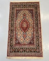 A PERSIAN MOUD CARPET, hand woven in the city of Moud, Khorasan Province, Iran. Material: hand woven