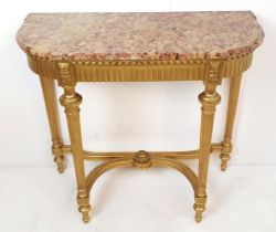 A VERY FINE 19TH CENTURY MARBLE TOP GILT CONSOLE TABLE, with breakfront, the frame decorated with a