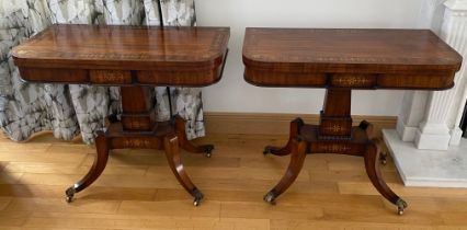 A VERY FINE PAIR OF FOLD OVER ROSEWOOD CARD TABLES, each with brass inlaid decoration, the tops open