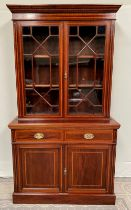 A VERY FINE EDWARDIAN MAHOGANY INLAID 2 DOOR GLAZED BOOKCASE, with stepped cornice having dentil det