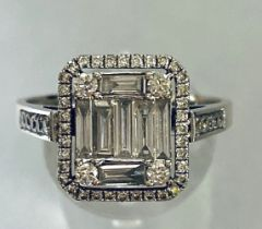 AN 18CT WHITE GOLD BAGUETTE AND ROUND BRILLIANT CUT DIAMOND RING, total diamond weight is 2.20cts ap