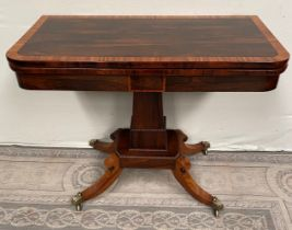 A FINE REGENCY ROSEWOOD FOLD OVER CARD TABLE, with cross-banded top having rounded corners, over a d