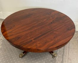 A GOOD QUALITY REGENCY ROSEWOOD CIRCULAR COFFEE TABLE, raised on a short turned column support with