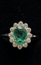 A BEAUTIFUL 18CT WHITE GOLD COLUMBIAN EMERALD AND DIAMOND CLUSTER RING, a wonderful handmade ring of