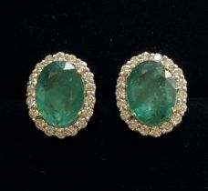 A PAIR OF 18CT WHITE GOLD STUNNING COLOMBIAN EMERALD AND DIAMOND CLUSTER EARRINGS, Emeralds: 6.70cts