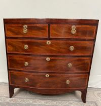 A VERY FINE AND ATTRACTIVE BOW FRONTED REGENCY MAHOGANY CHEST OF DRAWERS, with cross-banded and inla