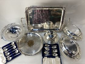 A pair of Mappin & Webb silver plated oval entree dishes, two cased sets of six Mappin & Webb silver