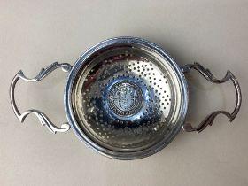 An Edward VIII silver tea strainer, coin inset Elizabeth I sixpence 1582, maker Walker & Hall,