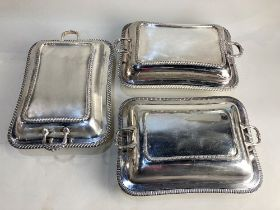 A pair of silver plated rectangular tureens and covers, with gadroon borders, together with