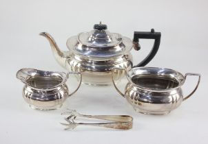 An Ashberry Sheffield silver plated three piece tea set, comprising tea pot, milk jug and sugar