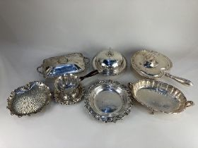 An Elkington & Co silver plated muffin dish, an entree dish, a sauce boat, and other items of silver