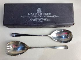 A pair of Elizabeth II silver old English pattern salad servers, makers Mappin & Webb, Sheffield
