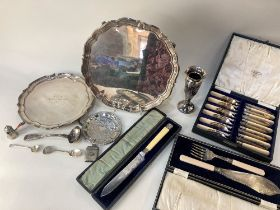 A collection of silver plated items, including two salvers, a cased set of six fish knives and