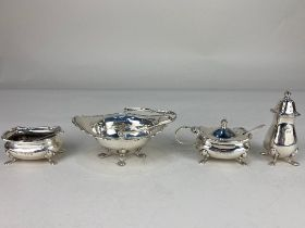 A George VI silver three piece matched cruet set, maker Walker & Hall, Chester 1938, 1939, with