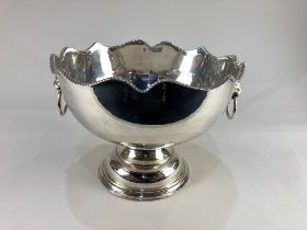 A silver plated punch bowl, with scalloped gadroon rim, lion mask ring handles and pedestal base,