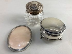 A George V silver circular dressing table box, makers Walker & Hall, Sheffield 1929, a silver lidded