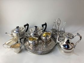 An Elkington & Co silver plated teapot, with naturalistic handle and finial, together with a two