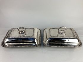 A matched pair of silver plated rectangular tureens and covers, with gadroon border and scrolling