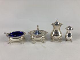 An Elizabeth II silver three piece cruet set, maker E J Houlston, Birmingham 1965, with blue glass