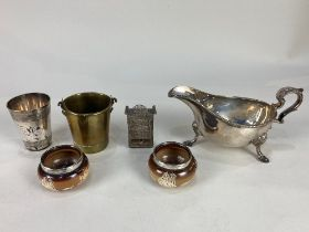 A pair of silver mounted Doulton Lambeth salts, a silver plated tot and sauce boat, a copper