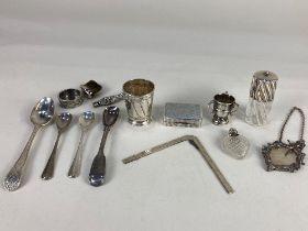 An Elizabeth II silver miniature mirror on long chain, surmounted with a bacchanalian cherub,