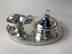 A silver plated oval galleried tea tray, a silver plated muffin dish and cover, and a silver