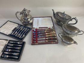 A Walker & Hall silver plated three piece tea set, and a Walker & Hall silver plated hot water