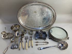A silver plated oval serving tray 50cm a circular mirror topped table stand on cast sphinx feet,