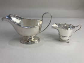 An Elizabeth II silver sauce boat, maker Mappin & Webb, Sheffield 1968, together with a silver cream