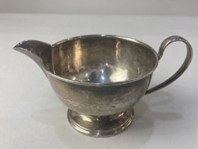 An Elizabeth II silver cream jug, maker Cooper Brothers & Sons Ltd, Sheffield 1963, of plain