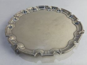 A George V silver salver, maker William Hutton & Sons, Sheffield 1924, with piecrust border, on